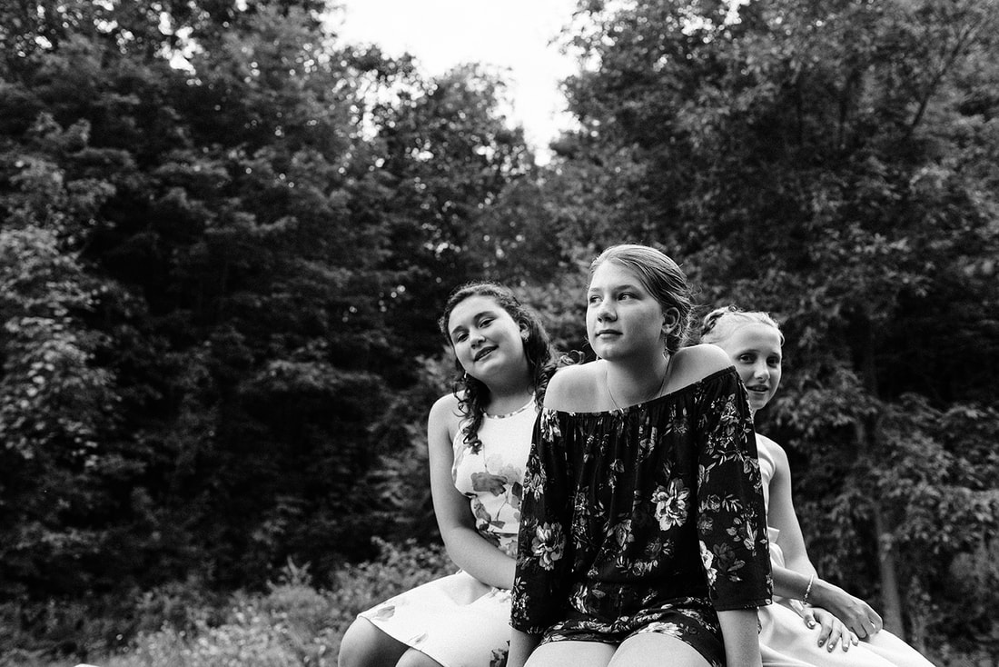 three young women at a wedding in Rockport Ontario